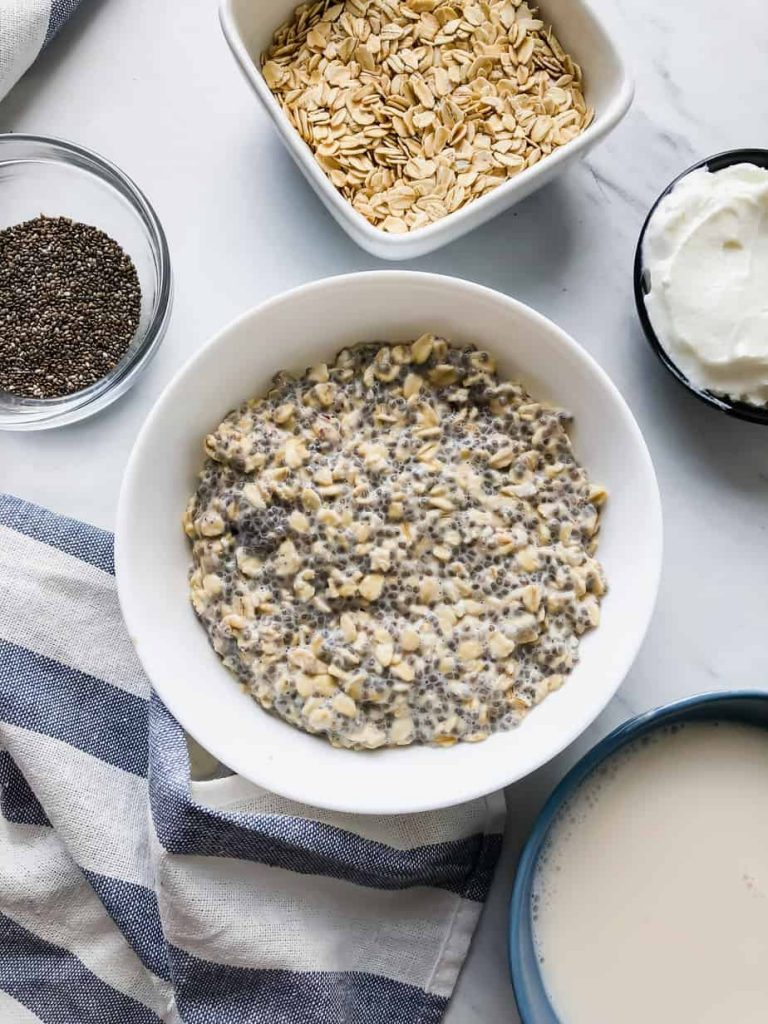 Overnight oats in a bowl with chia, almond milk, and yogurt